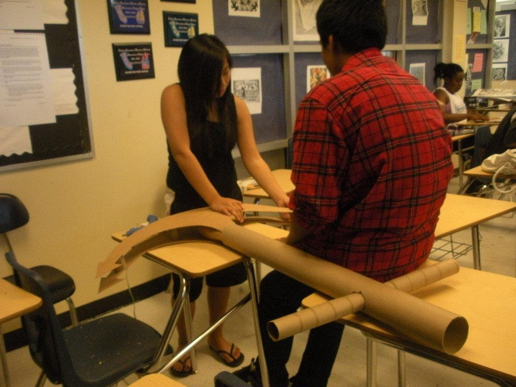 Senior Victoria Nguyen and Junior Rishi Jethi work on a large anchor for Homecoming Dance.