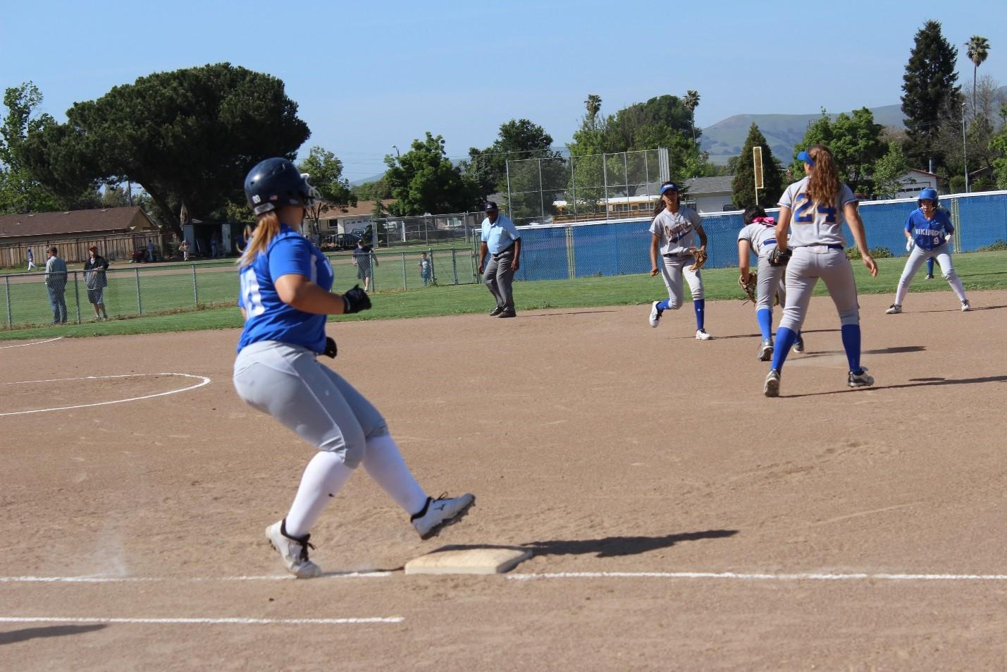 Vikings Battle Cougars in Varsity Softball Game