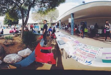 Junior Hossein Bakhshandeh stands behind his booth on freshmen MAZE day. (Photo: Christine Bach)