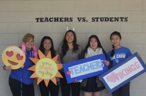 PE teacher Mrs. Martin pose for a picture with her sophomore students Angelica Shao, Sabrina Liu, Jeany Oh, and Qing Huang during lunch (Jessica Nguyen).