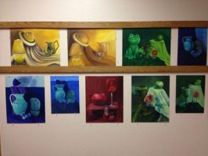 A collection of paintings done by Ms. Parker's AP studio art students.