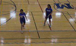 Jenny Lu lifts the birdie over the net.