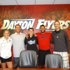 After making the team, Laura Hubacek (center) was able to have an official greeting with the coaching staff at the University of Dayton.  Photo Credit: Laura Hubacek
