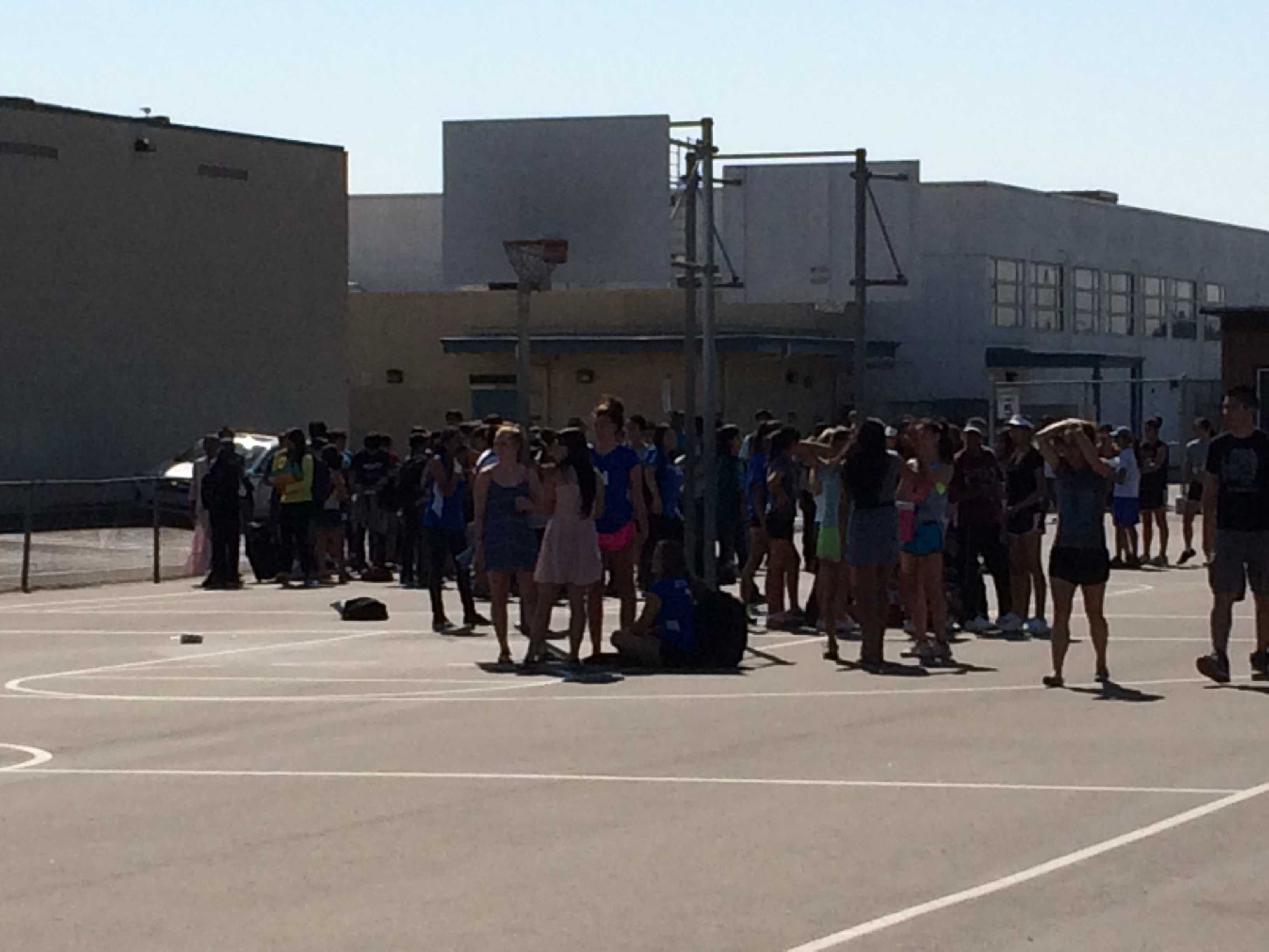 Irvington students still on campus evacuated onto the blacktop after the alarm sounded Photo: Rohit Dilip