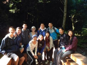 APES students pose for a picture in the Muir Woods forest after their lunch break.