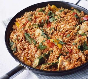 Jollof Rice in the process of being stir fried with chicken. PC: http://www.bbcgoodfood.com/recipes/4750/jollof-rice-with-chicken