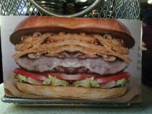 """The picture of the """"Counter Burger"""" on the menu rack that I had at The Counter in Fremont. PC: Channing Whitaker"""
