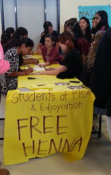 Students lined up for the henna booth at the health and wellness fair