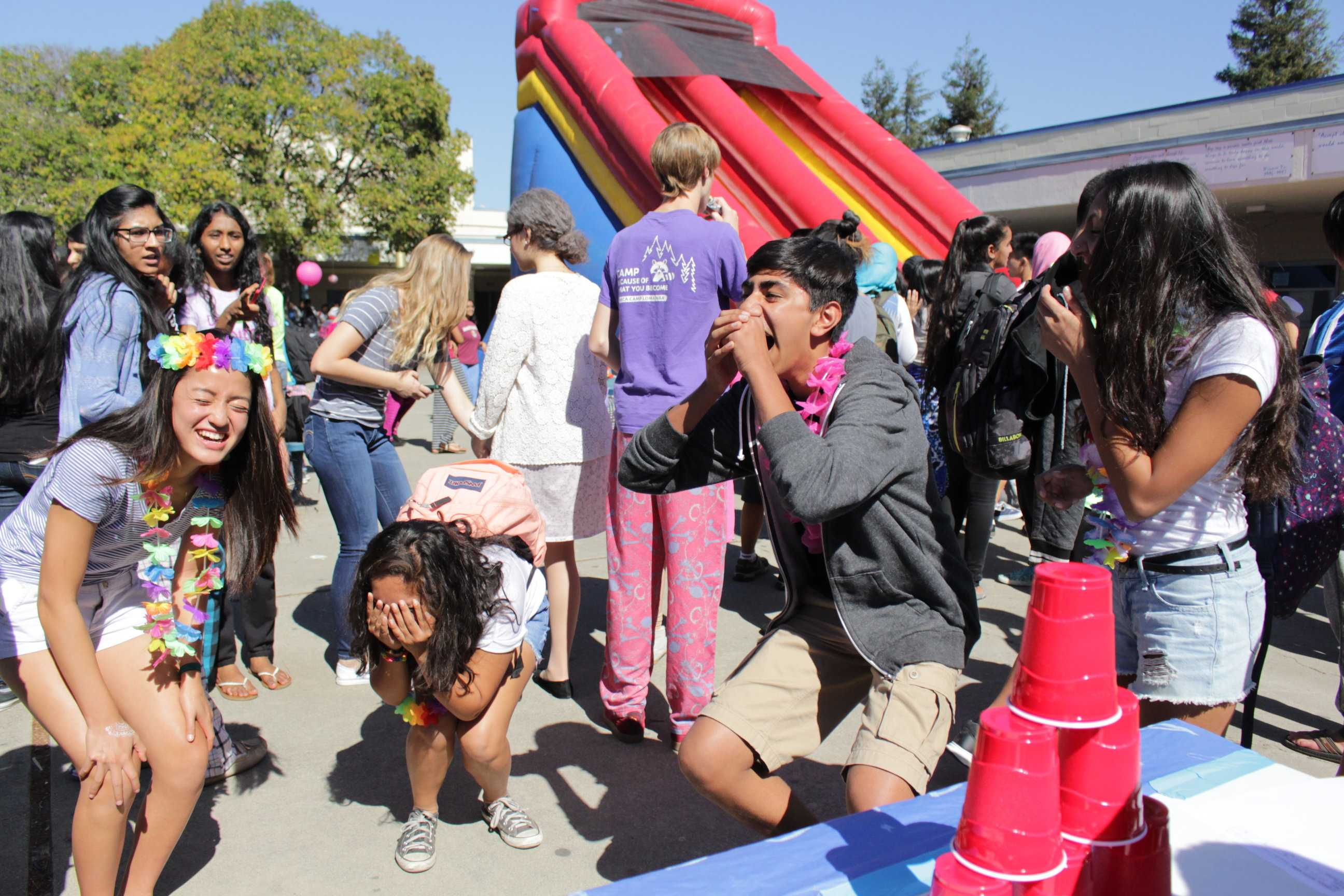 Carnival participants react to being unable to knock down the stack of cups at the Core Club booth. (Photo: Ayush Patel)