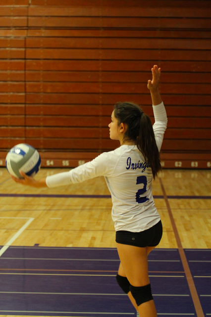 Sophomore Melissa Talbot prepares to serve (Photo: Ayush Patel).