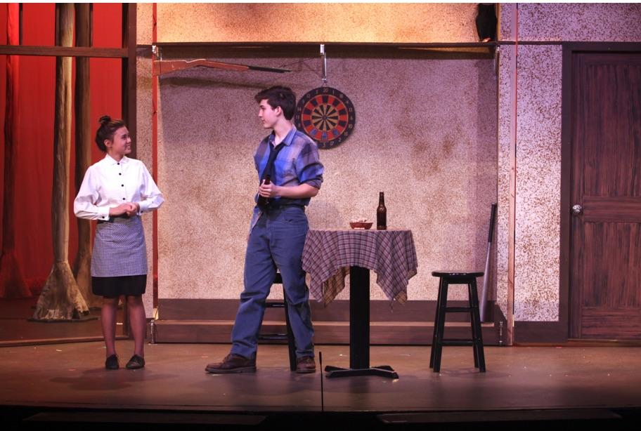 "Caption: Junior Aysiah Estores and senior Jacob Rosen play the Waitress and Jimmy in ""Sad and Glad."" (Photo: Caitlin Chen)"