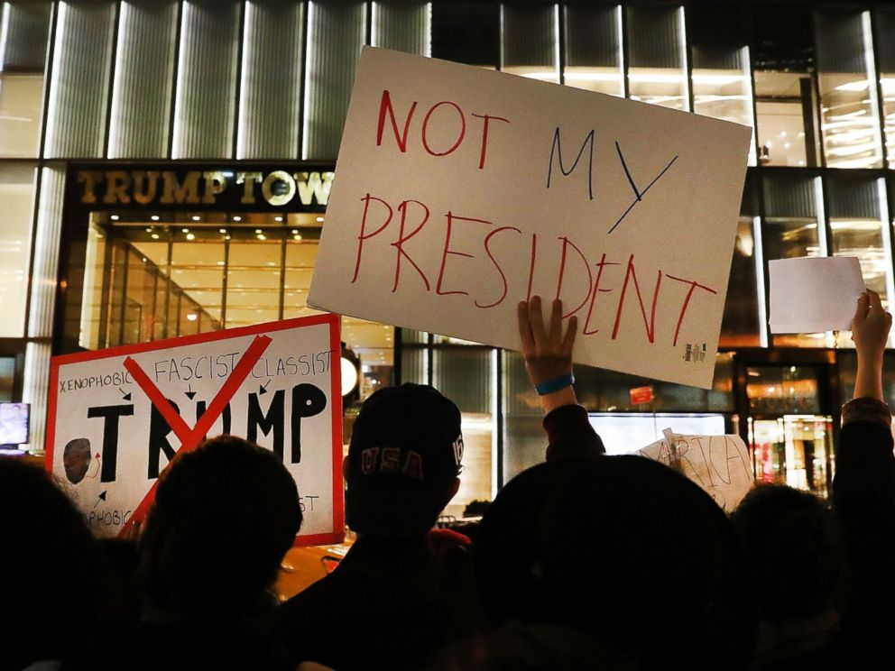 A group of protesters line up outside Trump Tower in New York a day after the election. Across the country, concerned and upset citizens came out in droves to voice their discontent with the election results.
