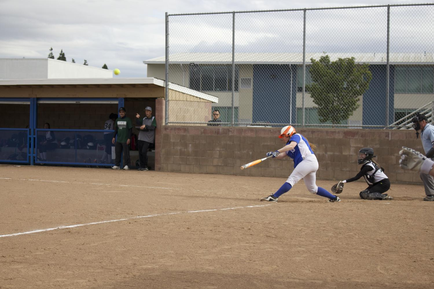 Courtney Sanders (11) hits the ball and scores the only home run of the game.