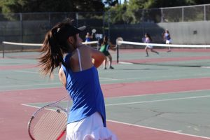 Doubles player Shanna Le (10) prepares to return the ball with a double handed backhand shot.