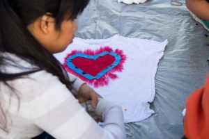 Students used rainbow colors to dye their shirts and custom designed their white crews by using tape to create hearts or patterns to display their pride.
