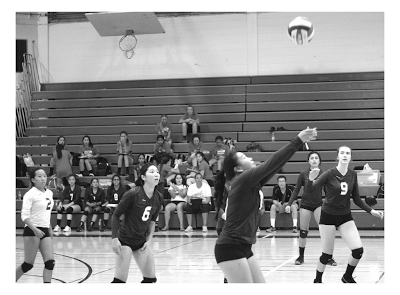 Girls' Varsity Volleyball prepares to score against American.