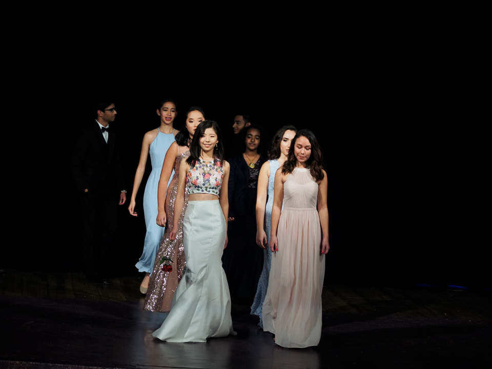 Models Adeline Arbis (10), Christina Chi (10), Kelcie Khinthi (11), Gianna D'Arrigo (11), and Simone Mendoza (10) strut down the stage at end of the formalwear exhibition.