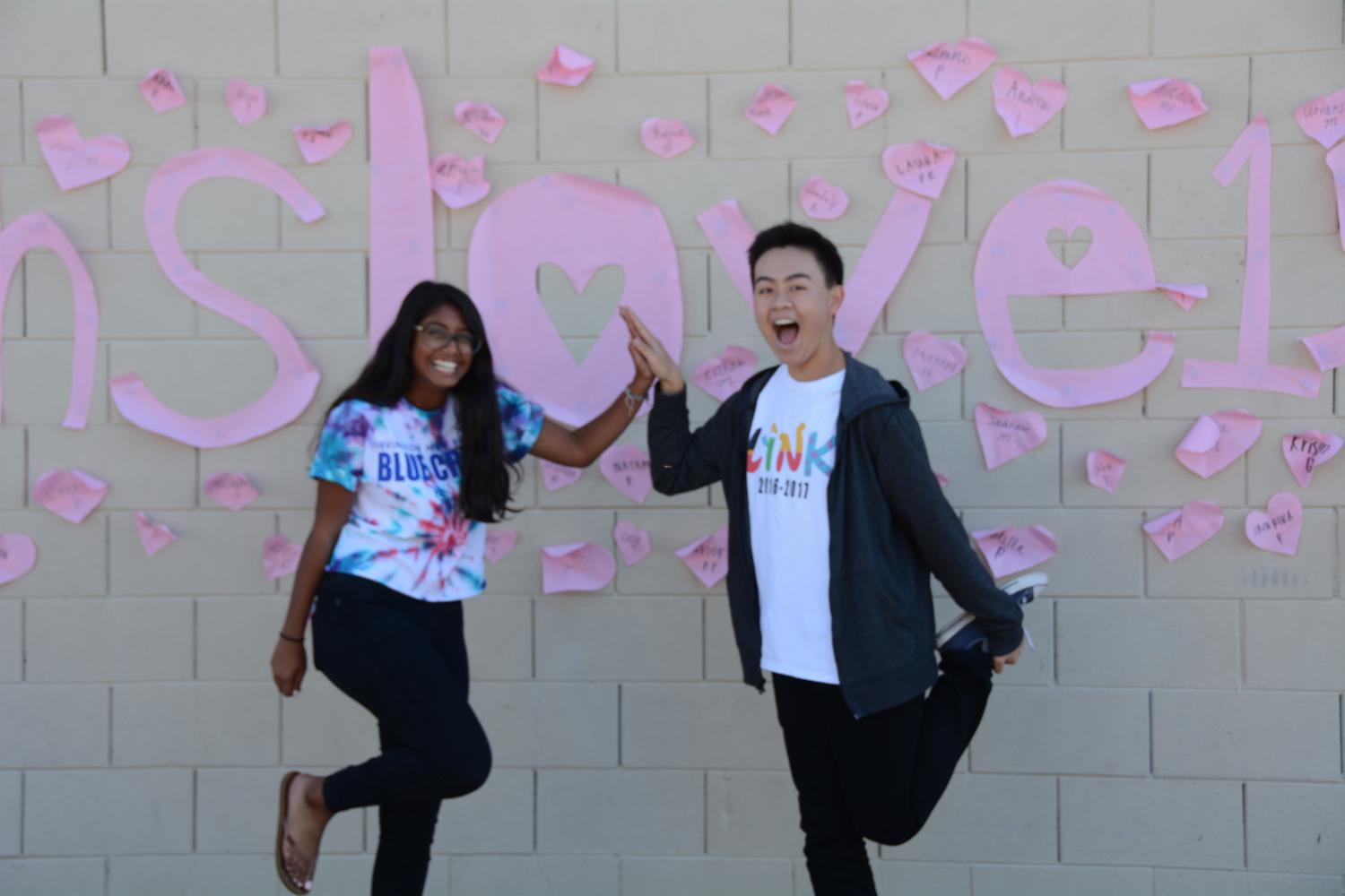 Juniors Sruti Nagam and Derick Nguyen pose in front of the #ihslove16 sign outside of the small gym. (Vivian Hoang)