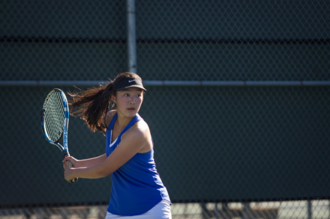 Senior and co-captain Amanda Tran prepares for a forehand. (Joseph Nguyen)