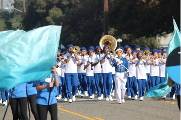 Drum major Kristen Wu leads the Junior Varsity Band in their final performance of the season. (Harrison Cheng)