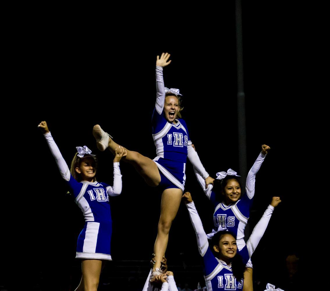 Irvington cheerleaders strike a spirited pose in the midst of their energetic performance.