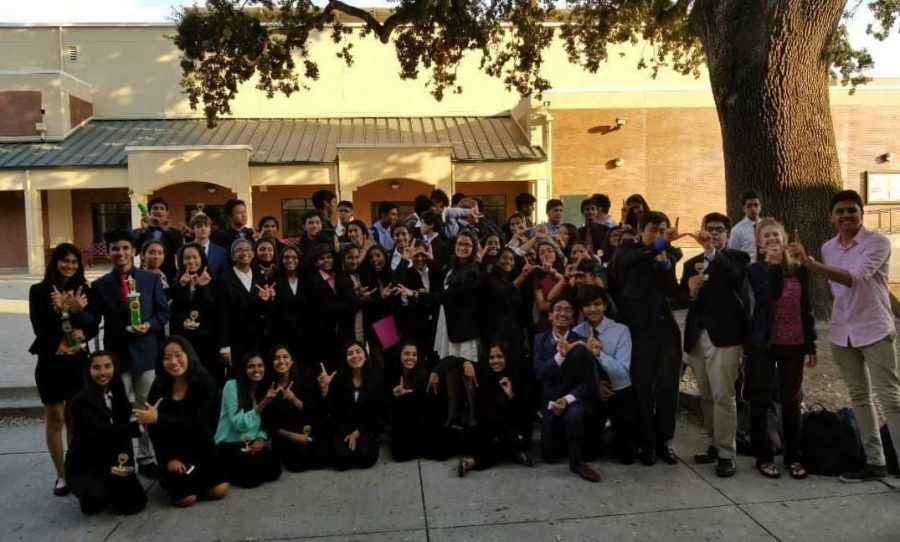 The+Irvington+Debate+team+rejoices+after+the+awards+ceremony.