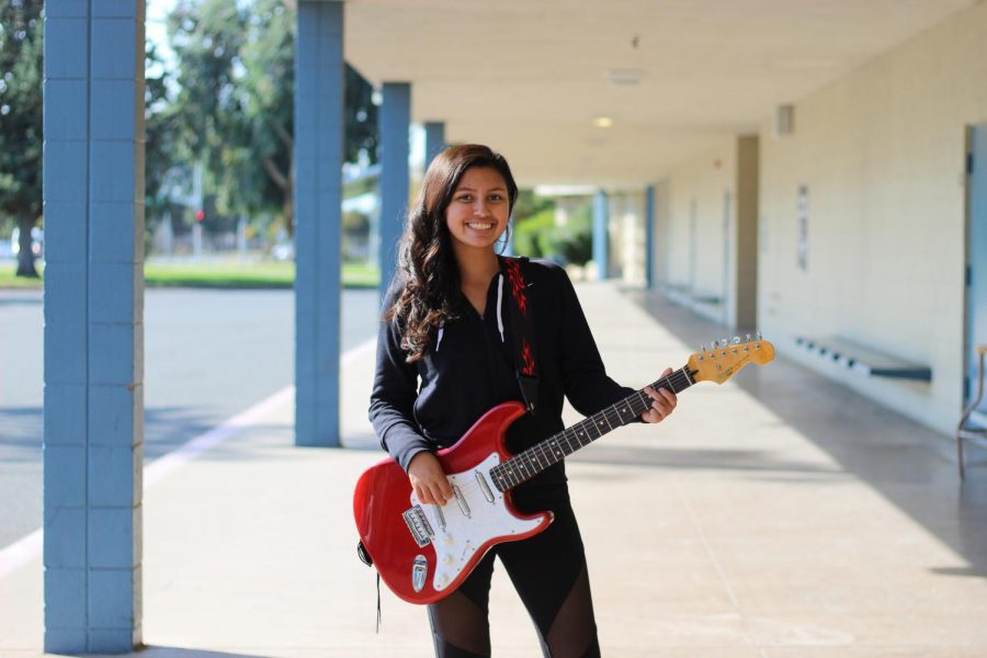 Cathryn Flores plays the both the electric guitar (shown) and the acoustic guitar as well as the ukulele and piano. Although her favorite instrument to play is the piano, she performs more with her guitars because the piano isn't easy to travel with.