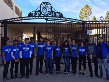 Team Azure poses outside Troy High School