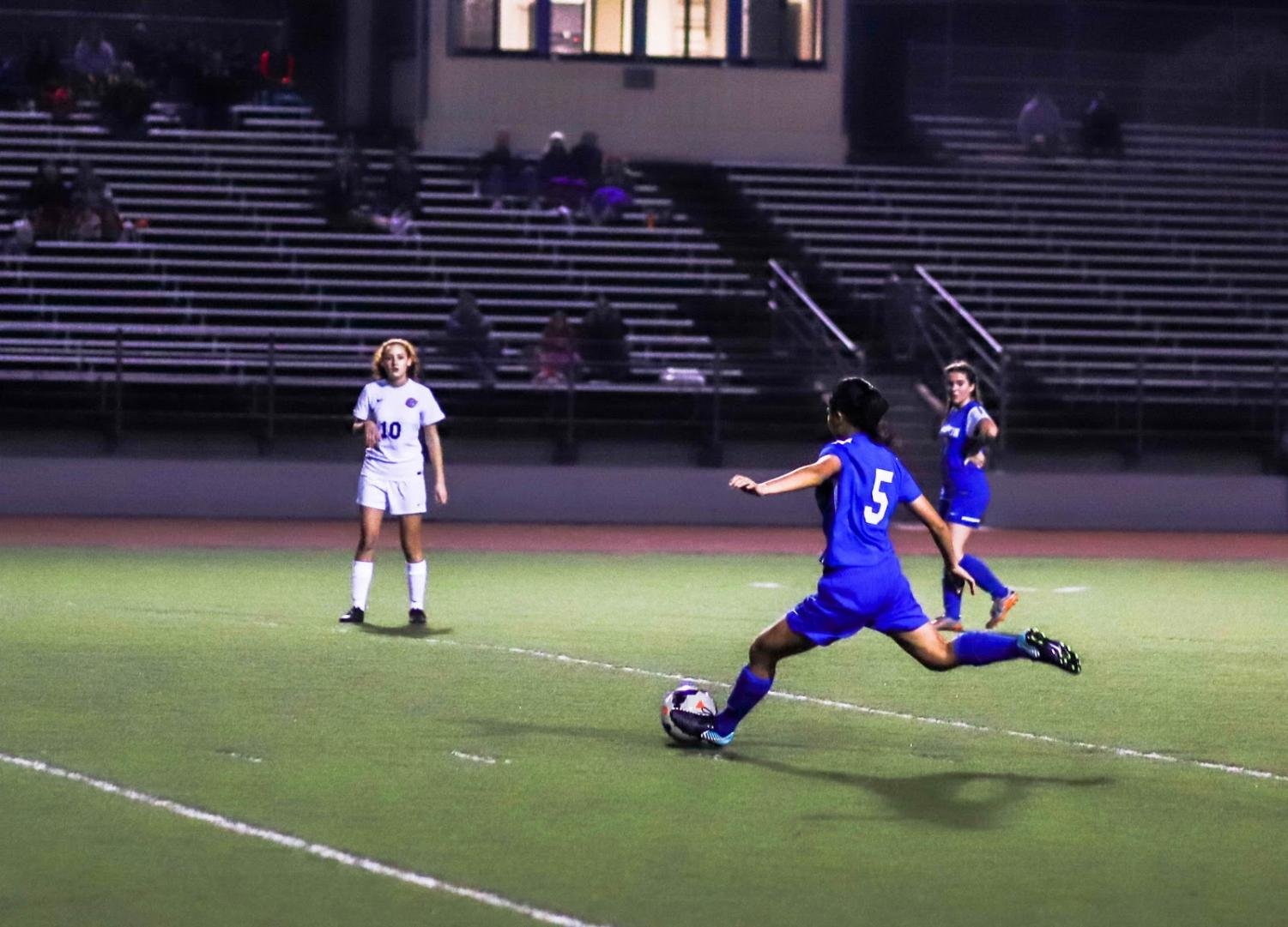 Gabriella del Rosario (11) makes a huge stride as she scores the second goal for Irvington