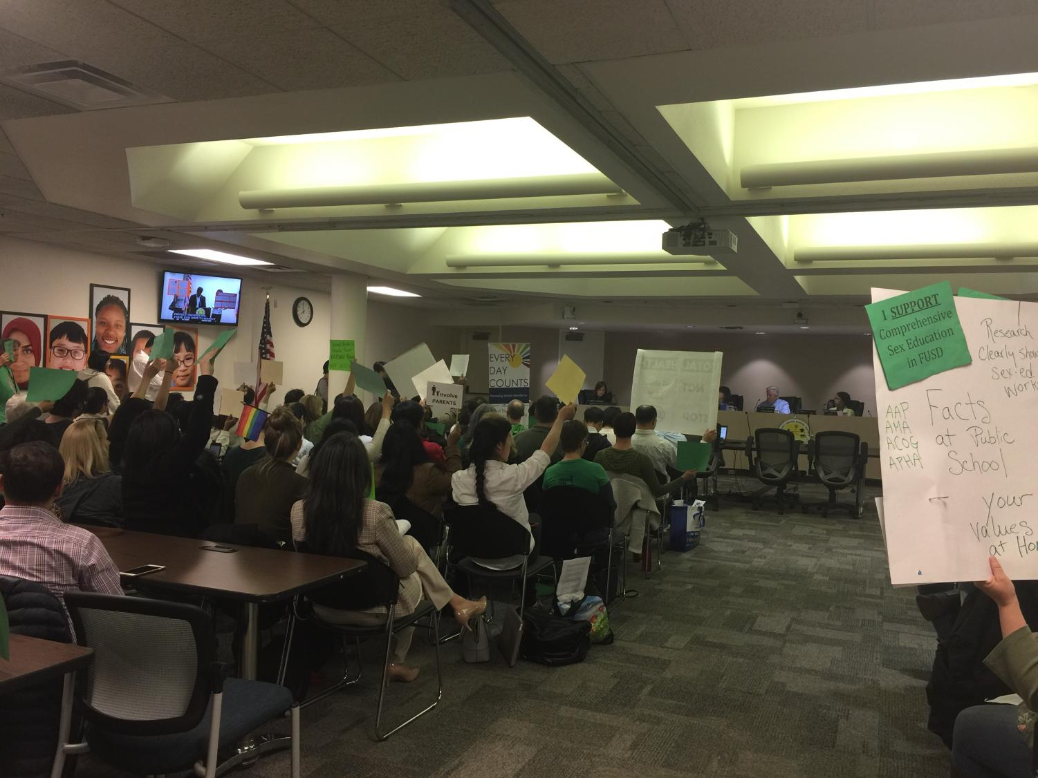 In the school board meeting on April 18, supporters of the policy wore green while people who were against the policy wore white. Parents and staff on both sides came up to voice their opinions about the program and created posters and signs to demonstrate their beliefs.