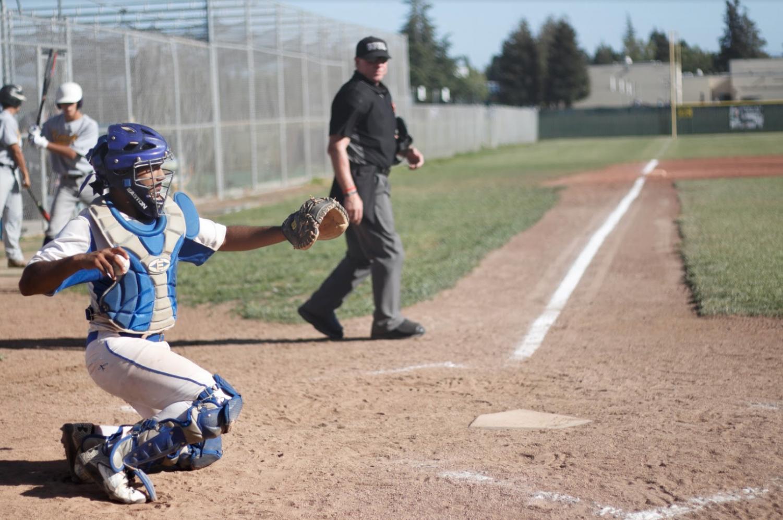 Irvington's catcher, Kanshat Patel (12) throws his pitcher another baseball.
