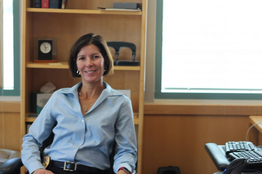 Kim Petersen, Stanford graduate, twenty-two year veteran to the police force, and first female Fremont police chief, poses for a picture at her office desk.