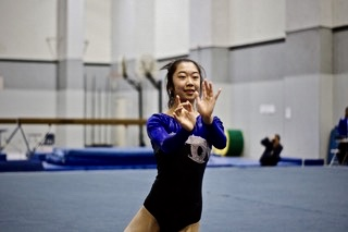 (Jessica Li (12) prepares to start her floor routine)
