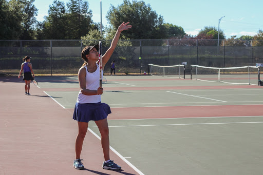 Priyanka Gupta-Martinez (10) steps up to serve a ball during the first set.