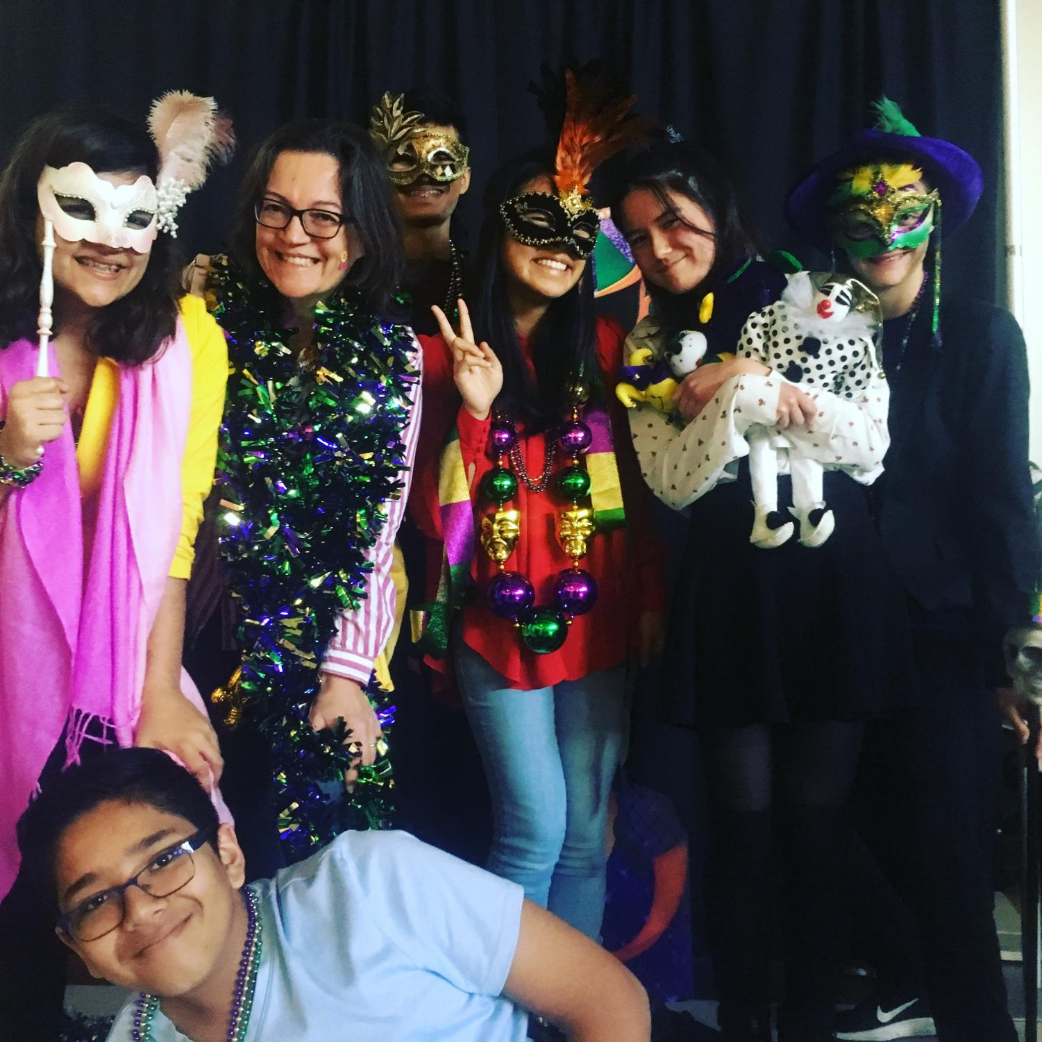 From left to right: Amadine Vardhan, Mme Cayla, Neil Karkhanis, Nicole Huynh, Jessica Mason, Jack Merrell, and Ronit Gupta pose at the Mardi Gras photo booth.