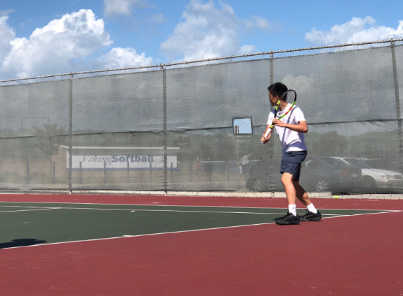 Luc Phan (10) gets ready to return a shot from the opposing team.