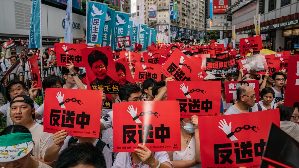 Hong Kongers can be seen protesting against an extradition bill that will require Hong Kong prisoners to hold trial in mainland China
