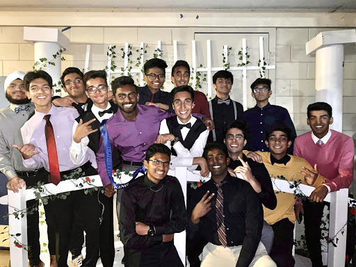 Class of 2020 boys pose in front of the bridge and backdrop decorations at Irvington's 2019 homecoming dance.