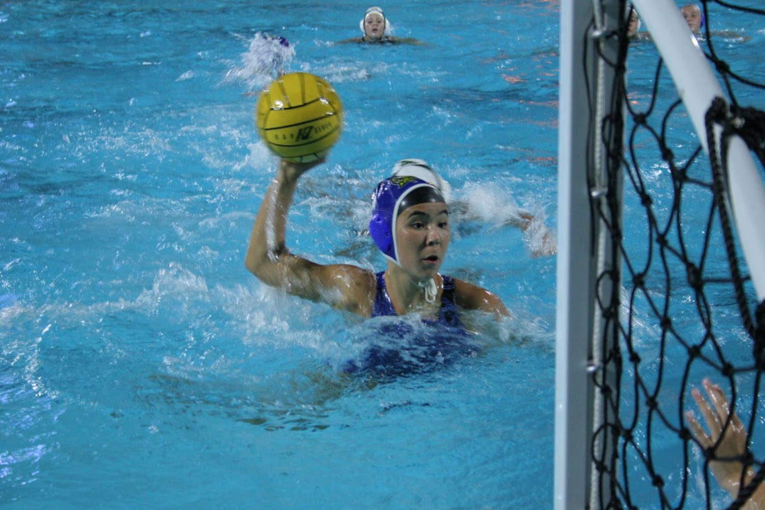 Noelani Takei (11) made four goals throughout the game, bringing herself close to the net to ensure a higher chance of scoring. Successful shots like these were the reason behind Irvington's wide score margin against Moreau.