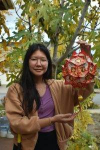 During Tết, Crystal Nguyen (11) and her family decorate their home with lanterns made out of red envelopes.