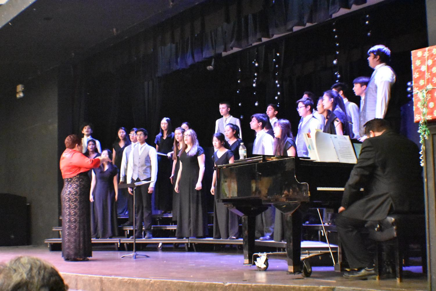 Part of performing during a choir concert involves paying close attention to Ms. Olsen's conducting and knowing when to enter into the song.