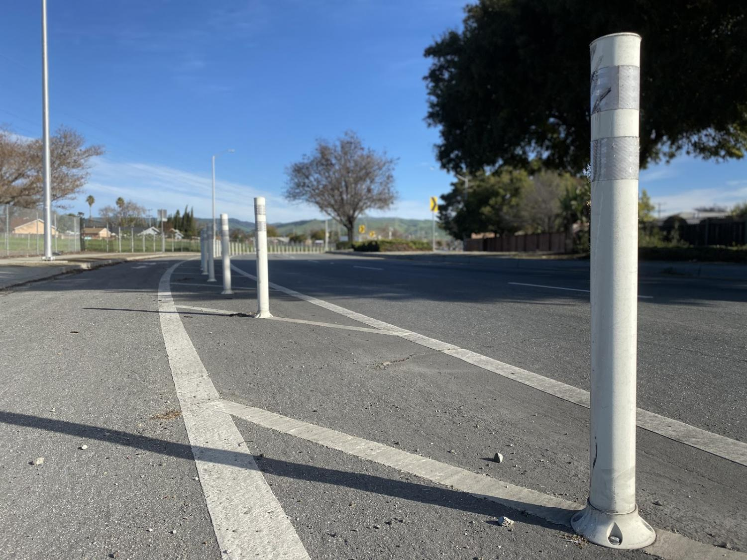Bike poles can be seen in front of the Main Fremont Library