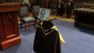 Picture Credit: BBC News: Above is a picture of a distant education graduate; the Irvington Voice correspondent could not get a proper picture due to the blurry nature of the livestream, but has been provided this by the Irvington administration as a valid depiction of the ceremony and its intentions.