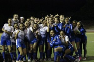 The 2019-2020 Varsity Girls Soccer team shows the close bond between the upperclassmen and the underclassmen, with both groups smiling at the end of a successful season.