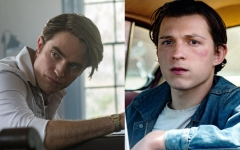 Pictured: Robert Pattison (left), who stars as Preston Teagardin, a dubious and immoral preacher and an outsider to the town of Knockemstiff, Ohio. Tom Holland (right), who stars as Arvin Russell, a young man embroiled in a series of mysterious, devilish events.