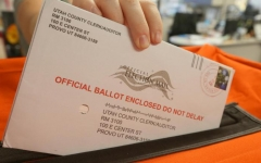Mail-in ballots can be mailed out at official drop-boxes or can be put back into the mail.