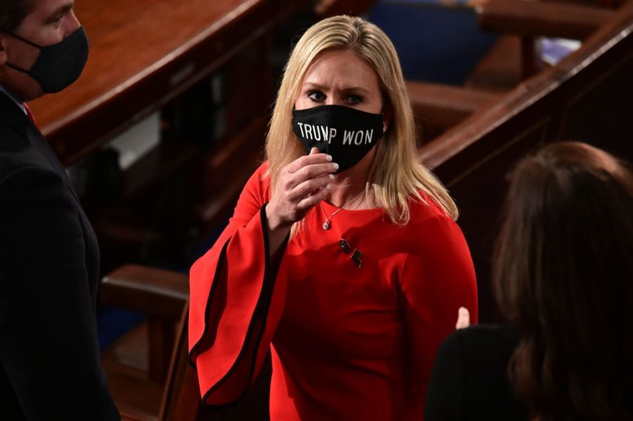 """Representative Marjorie Taylor Greene wears a mask reading """"Trump Won,"""" three days before the deadly insurrection at the Capitol."""