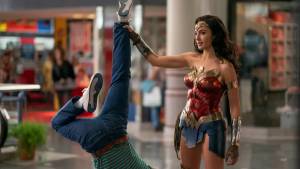Diana Prince, played by Gal Gadot, having just caught a burglar in the mall.
