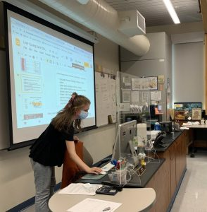 Ms. Koehler, an AP Biology teacher, instructs her class while following precautionary COVID-19 protocols.