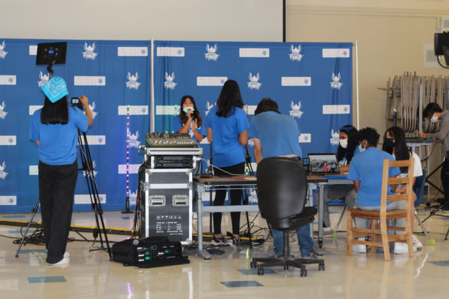 Ampelia Gomez (12) sang the national anthem during the rally as ASG members worked to record the performance and ensure its projection on YouTube.
